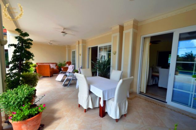 Dining table by the pool covered terrace