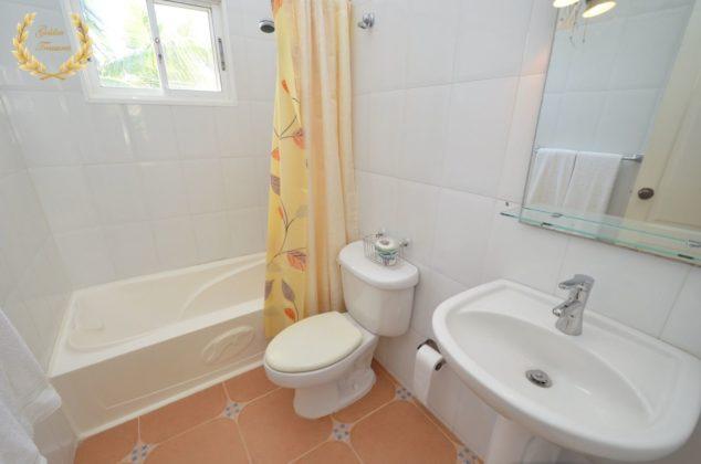 Orange and teal bathroom