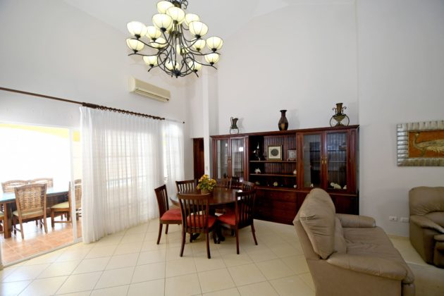 The villa has a nice living room with classic furniture