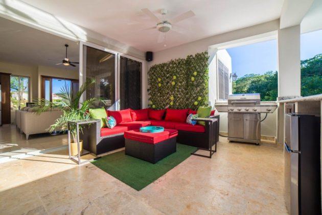 red sofas under the veranda