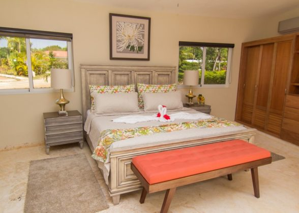 master suite bed with bench